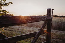 Private Signboard On Wooden Gate Against Sky During Sunset
