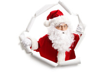 Santa Claus Emerging From A Pa...