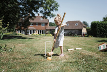Girl Playing Croquet On Lawn A...