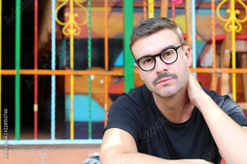 Man with mustache and eyeglasses