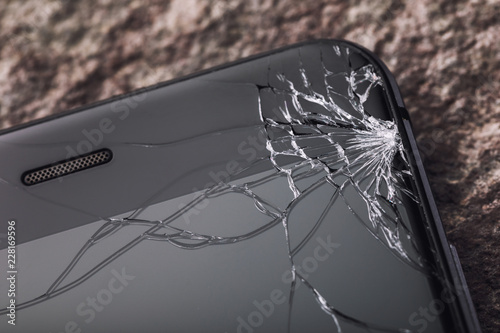 Broken glass on the phone screen, close-up