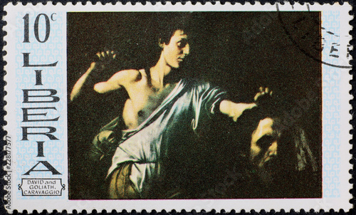 Fototapeta  David and Goliath by Caravaggio on postage stamp