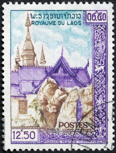 Fotografia  Temples on postage stamp of Laos