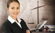 Leinwandbild Motiv Scales of justice and businesswoman sitting at