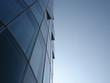 canvas print picture - Imposante spiegelglatte Glasfassade eines Wolkenkratzers