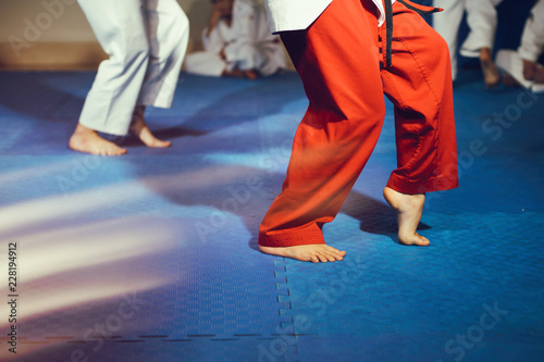 Taekwondo athletes bare feet martial arts movement on floor