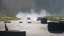 Cars Taking The Turn Through S...