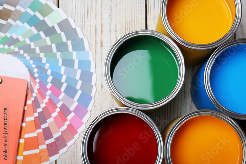 Obraz Cans with paint and color palette on wooden background, top view - fototapety do salonu