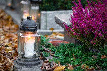Flowers And Candles On A Colorful Polish Cemetery. Autumn, Preparations For All Saints' Day.