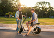 Lovely young couple with electric bike. Modern city transportation