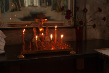 Inside Ortodox Church, Candles In Front Of Cross