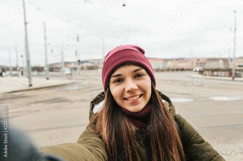Cuadros en Lienzo Beautiful girl making selfie on the street in Prague in the winter season