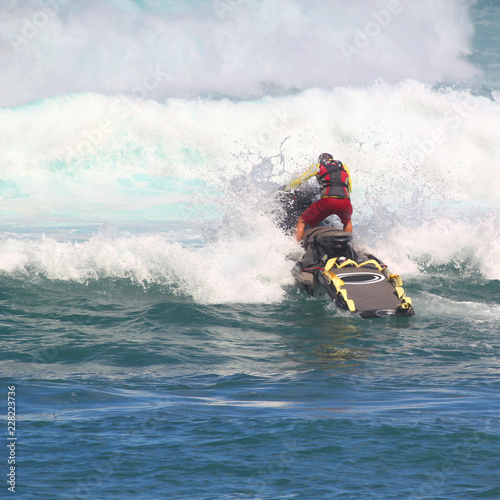 Garden Poster Water Motor sports MAUI, HAWAII-NOV 10: Unidentified lifeguard on a jet ski practices rescues in heavy winter surf.
