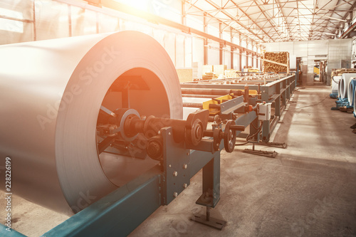 Obraz Industrial galvanized steel roll coil for metal sheet forming machine in metalwork factory workshop - fototapety do salonu