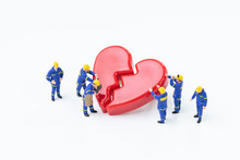 Miniature People Cute Technician Workers Team With Uniform Help Fixing Or Repair Red Broken Heart On White Background Use In Love Relationship, Divorce, Couple Feeling Or Health And Medical Concept