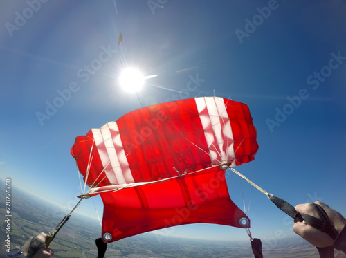 First person view of a red parachute