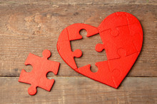 Heart Puzzle Red On A Wooden Background. Concept Second Half Of The Heart In Love For Valentine's Day Or Illness