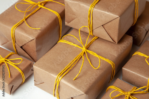 Gift Boxes In Festive Packaging With Golden Yellow Bows Delivery Of