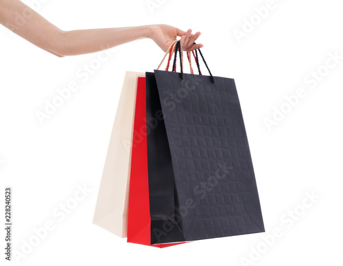 Photo hand holding shopping bag isolated on white background