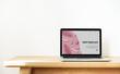 Leinwanddruck Bild - Laptop showing website template on a wooden table