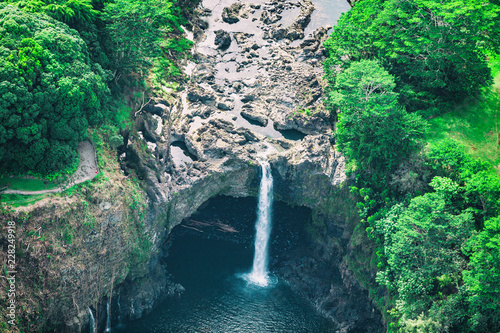 Spoed Foto op Canvas Verenigde Staten Hawaii Rainbow Falls waterfall near Hilo, Big Island. USA travel. Aerial top view from helicopter.