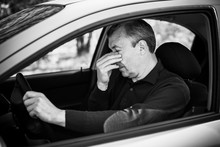 Portrait Of Stressed Mature Man In Car Drivers Seat. Crisis Of Middle Age And Man's Life After 50 Years. Senior Serious Or Sad Or Depressed Man Sitting In His Car, Toned