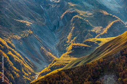 Papiers peints Bleu vert Waterfall in the mountains