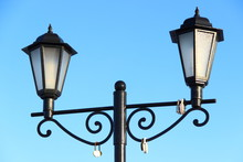 Street Lamp On Blue Sky Background - Beautiful Old Forged Lantern With Two Faceted Lamps
