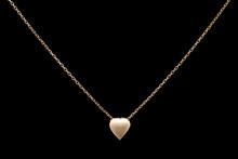 Golden Necklace On A Black Bac...