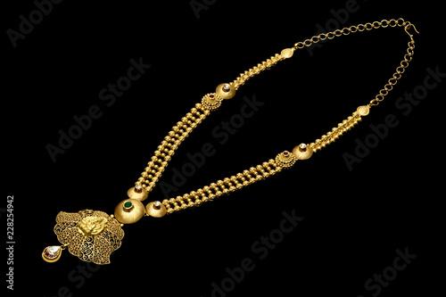 Foto  Golden necklace on a black background