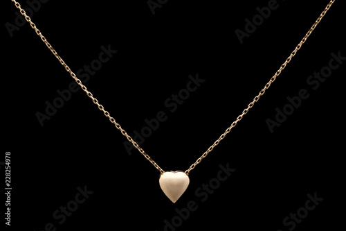 Fototapeta Golden necklace on a black background