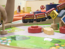 Wooden Train Set - Child Boy Play With Red Train Move On Railways Going Round A Bend With Bridge In Backdrop,Toddler Toys For Kids Indoor Playground