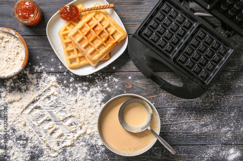Fotografie, Obraz Modern waffle maker with ingredients on wooden table