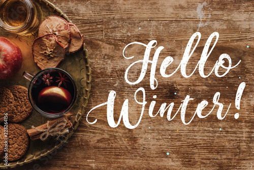 Foto op Canvas Kerstmis top view of mulled wine in cup and greeting Hello Winter on table, christmas concept