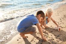 Cute Little Children Gathering Sea Shells On Beach