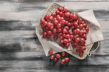 Tray With Red Grapes On Wooden Table