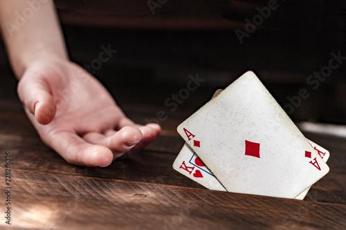 Foto  Card addiction. Dependence on poker, gambling. Gambling concept
