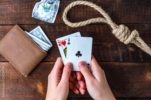 Photo  Card addiction. Dependence on poker. Gambling concept