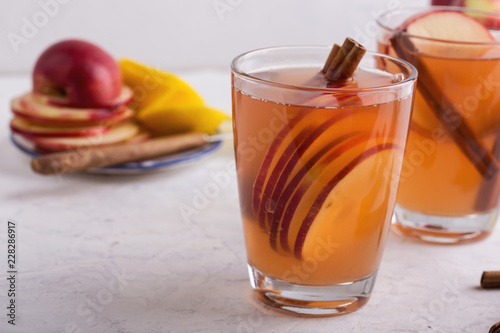 Hot cozy autumn and winter mulled cider drinks with apple slices