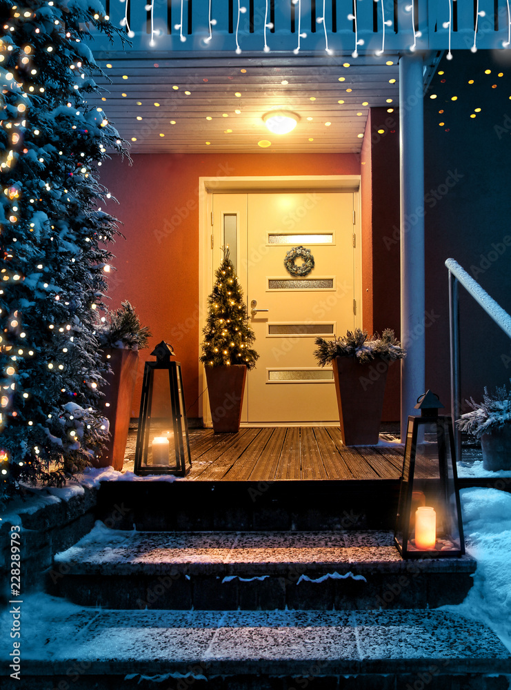 Fototapeta Welcome Christmas house entrance door in Xmas evening