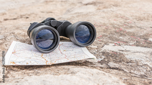 the binoculars on the old map orienteering Hiking direction stone background Canvas Print