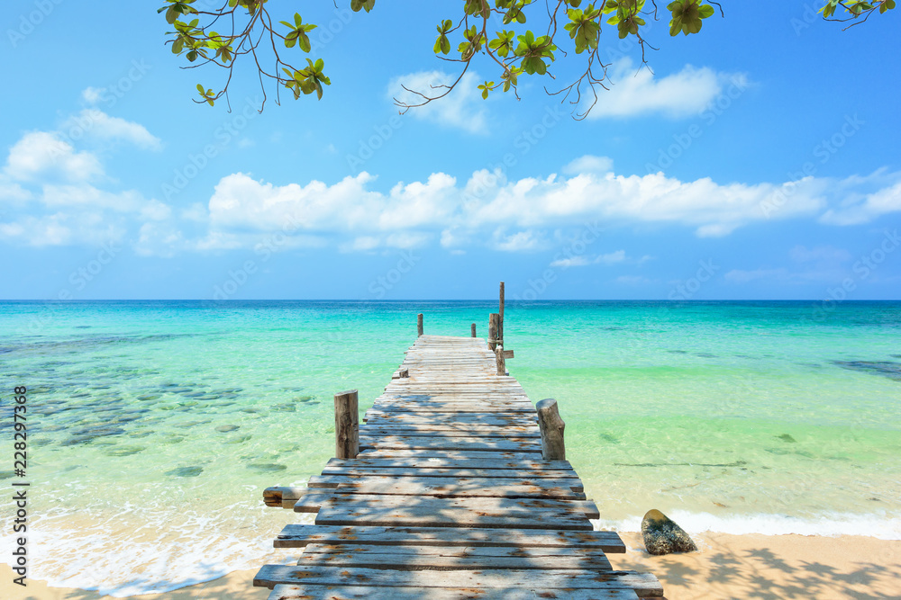 Long wooden bridge go to the sea in beautiful tropical island, Thailand.