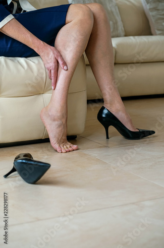 Fotografia  Senior lady suffering from leg pain