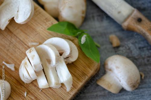 Fototapeta Natural organic raw mushrooms of sliced   on table obraz