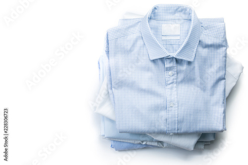 Stack of male folded shirts isolated on white