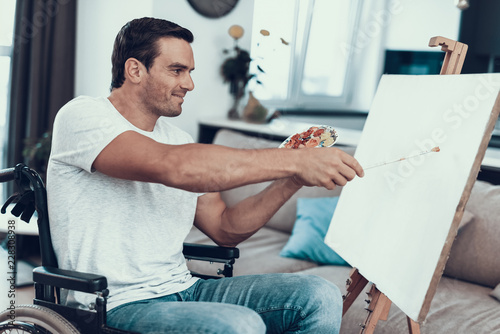 Valokuva  Handsome Disabled Young Man Painting Picture