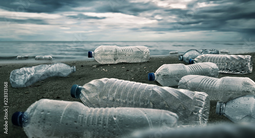 Fotografia, Obraz  Plastic water bottles pollution in ocean (Environment concept)