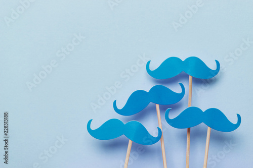 Blue moustache on a Blue background Fototapet