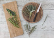 Fresh Provencal herbs, knife and   wooden boards