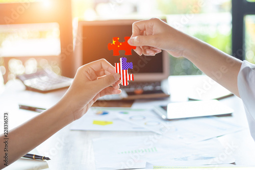 Fototapety, obrazy: Two businesswoman connecting elements of China and the USA jigsaw puzzle